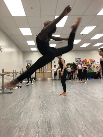 Cordell Aikman tests her flexibility by taking a leap in one of her dances!