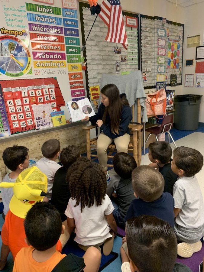 Constanza Hernandez, LIA student, reading a spooky story to a bilingual kindergartner class.