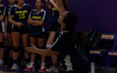 8th grader Ana Mayo serves the volleyball to start the match on last year's volleyball team.