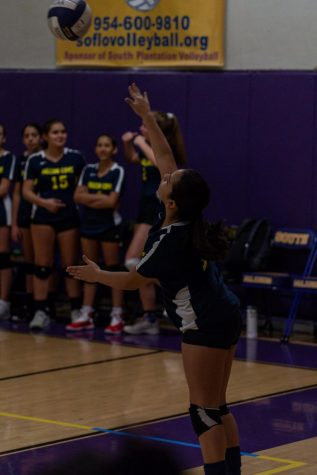 8th grader Ana Mayo serves the volleyball to start the match on last year