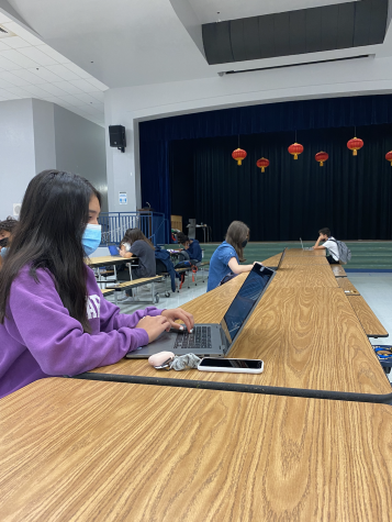 Students at Falcon Cove Middle School accessing websites for their schoolwork, socially distanced