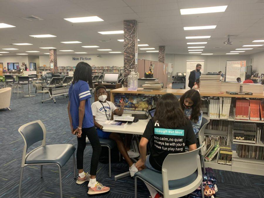Peer tutors helping FCMS students.
